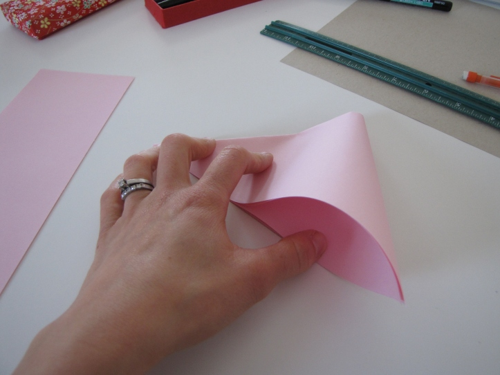 Fold to make a smaller triangle.
