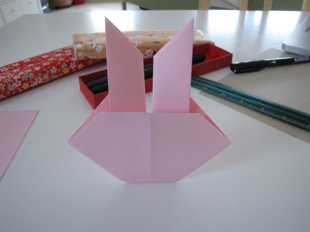 Your bunny just needs a face now. Notice that the last fold acts as a stand.