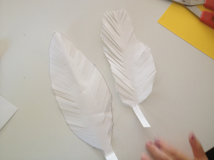 make long cuts all along both sides of your feathers