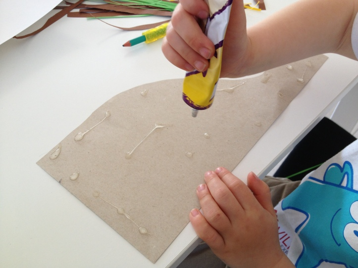 Glue your nest onto a piece of white paper.