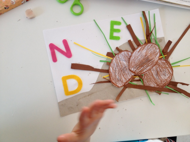 Add your dinosaur eggs and the letters D,N and E for dinosaur, nest and eggs.