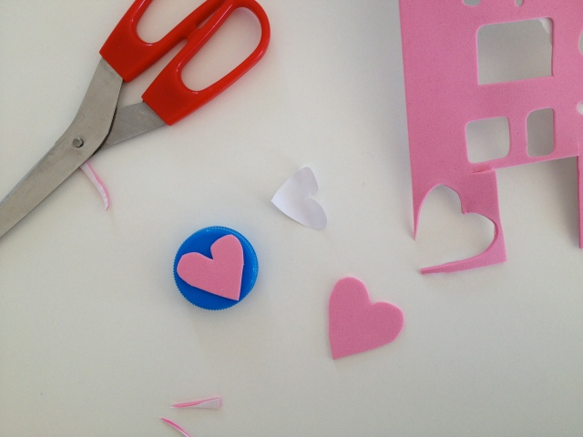 make a stamp out of bottle tops and foam with a sticker backing