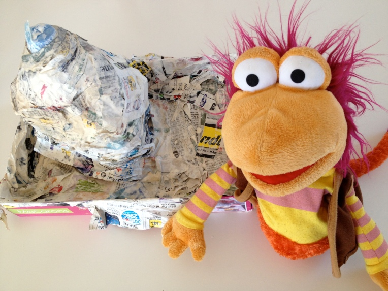Gobo stands proudly next to our paper mache volcano