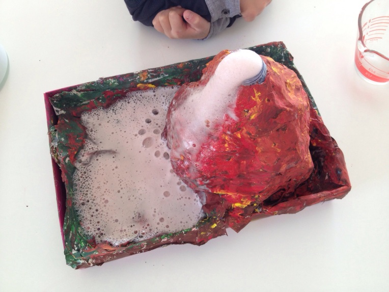 Pour about half a cup of vinegar into the bottle and watch as your volcano erupts!