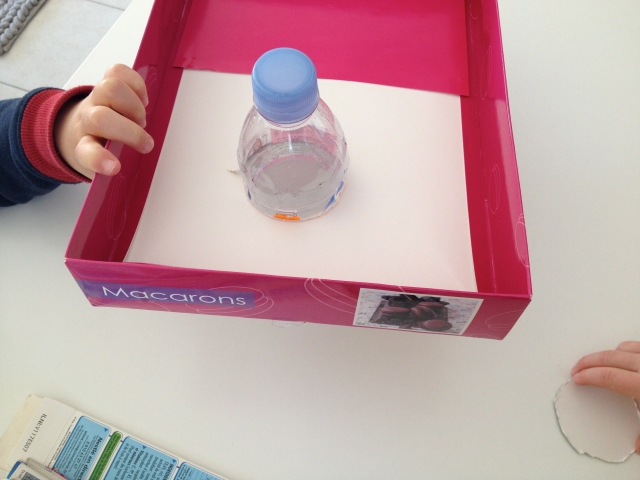 Pass your bottle through the hole to make sure that it's large enough.