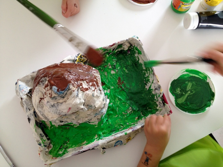 Paint your volcano in greens and browns first.