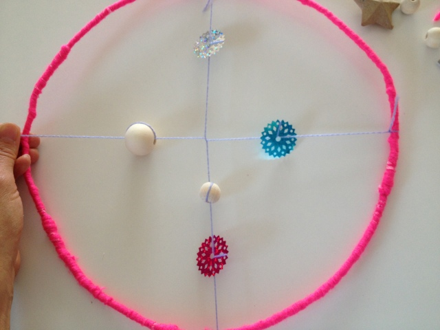 Now decorate the second half before tying it to the other side of your circle.