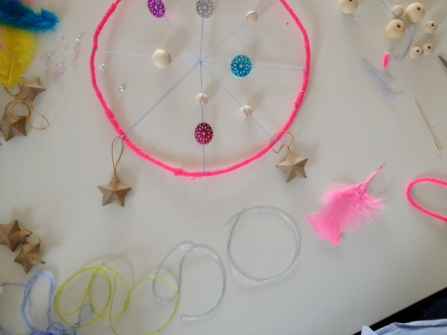 Add some pieces of yarn to the bottom portion of your dream catcher.