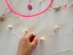 Make a knot around your beads to hold them in place.