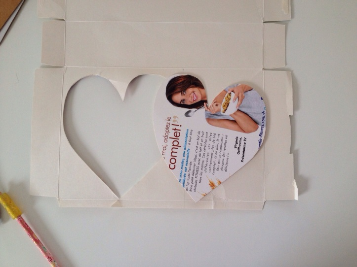 Cut out a large heart from a cereal box.