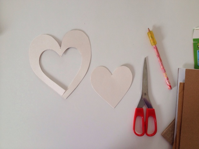 cut out a small heart from the large one