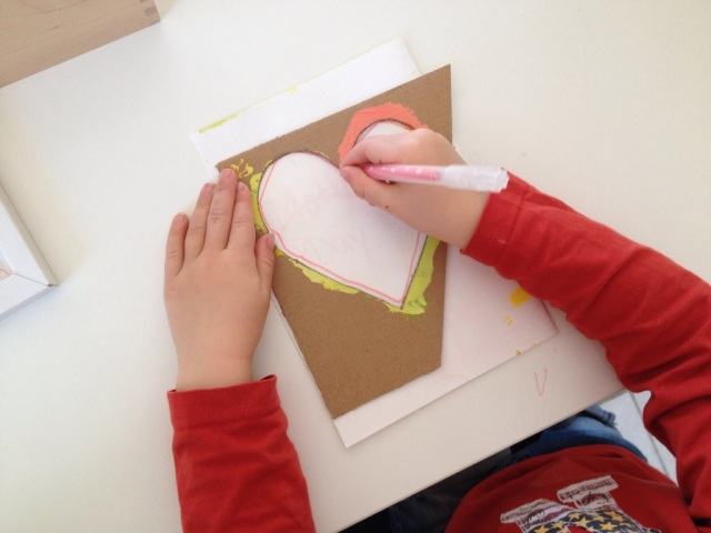 Use the stencils that you used to make your heart decoration on your card.
