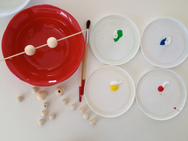 Use a skewer to make it easier to paint your beads.